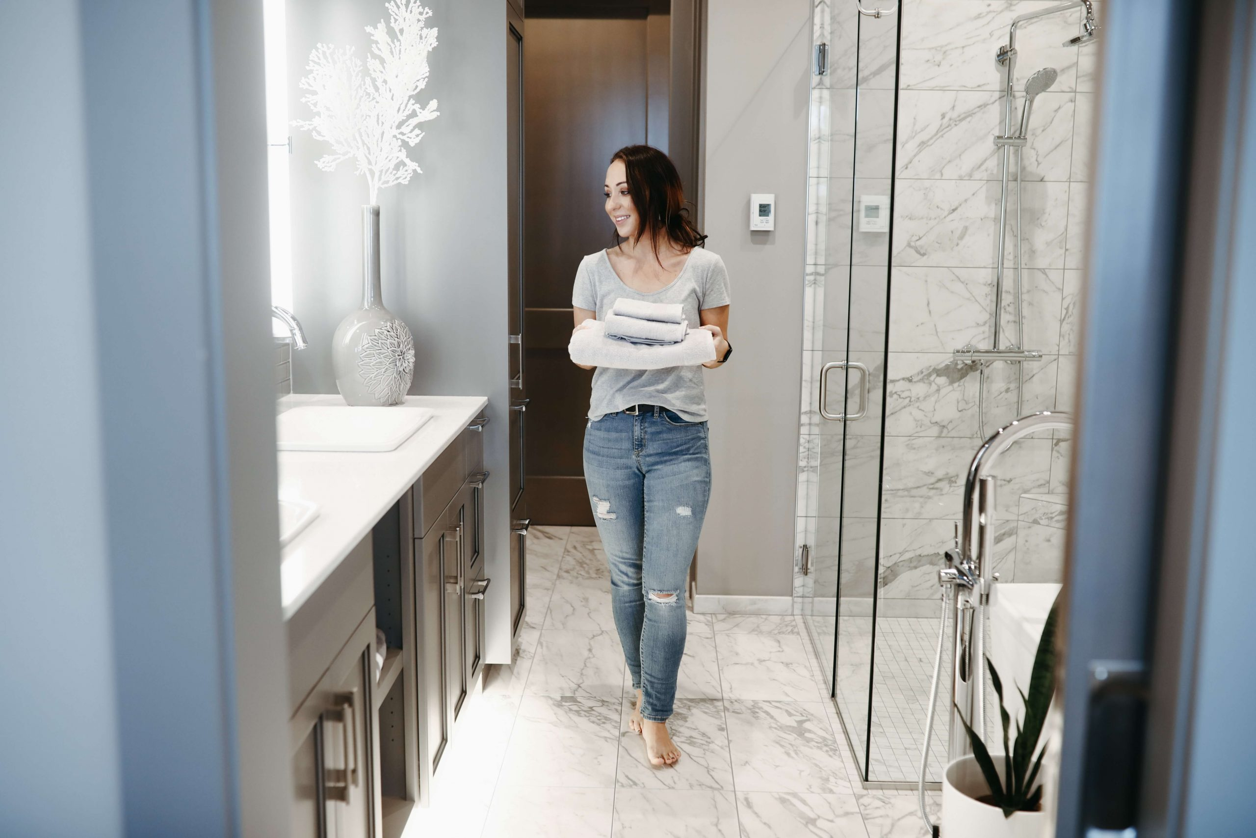 woman stepping on clean tile in chicago bathroom